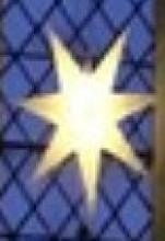 Lit up star in chuch window